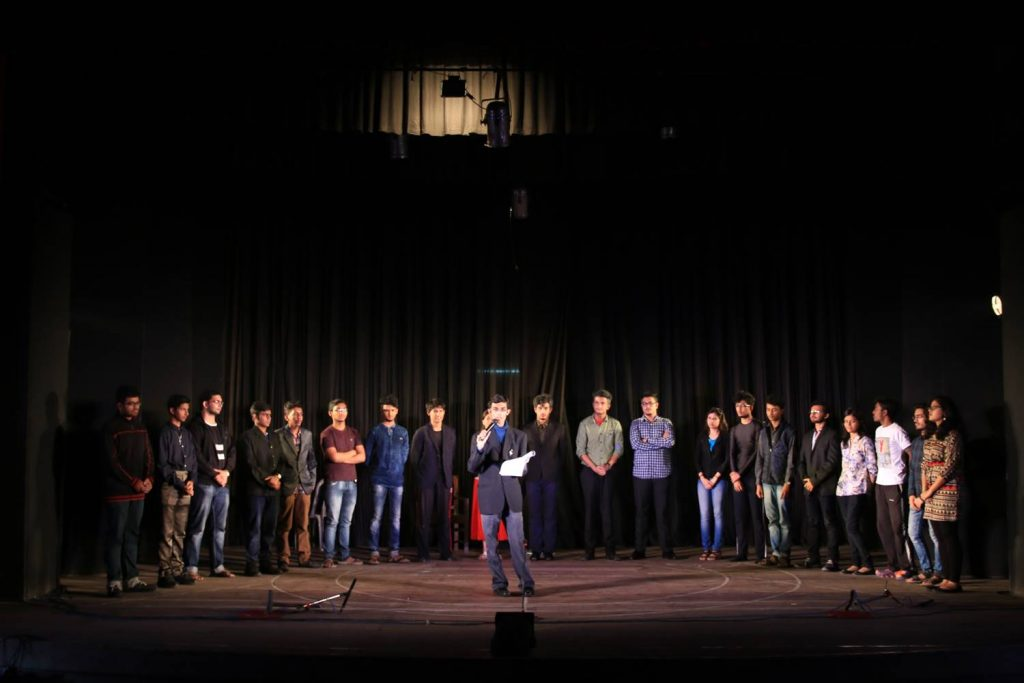 Curtain call - SYP Hamlet 2016, The Team. Front centre: Dr. Nilanko Mallik (director) Team members from left to right: Neeralun Mukherjee (lights), Archik Guha (priest and prompter), Kisholaya Majundar (videography and floor management), Avradip Parui (Guidenstern), Subhabrata Dutta (Rosencrantz), Niloy Ghosh (Bernardo), Rittik Patra (Horatio), Srijeet Sarkar (Hamlet), Srayashi Ghosh (Gertrude), Arijit Ghosh (Hamlet the Senior and Player King), Agnibha Bandyopadhyay (Claudius), Swagato kabiraj (Polonius), Anupama Das (Ophelia), Debdut Hore (Laertes), Kaustabh Adhya (Live music and Lucianus), Sagnik Bagchi (recorded music and Fortinbras), Kasturi Banerjee (Player 2), Sattwik Dey (Gravedigger), Sayantan Ganguli (Curtains), Poulami Nag (Announcer).